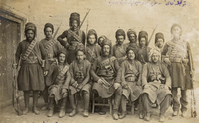 An original photograph from the ancient twon of Van, South East turkey showing an irregular militant group that attached Armenians and Assyrians villages in the area of Van